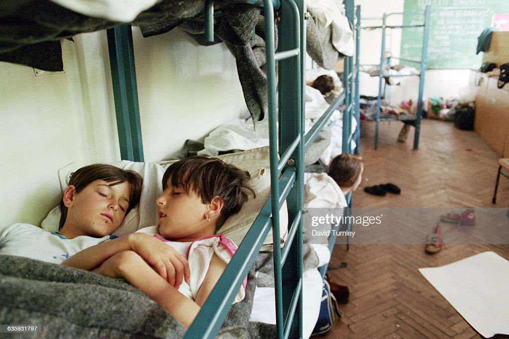 Nineyearold twins Nizana and Dzenana Abaspahic share a bed at a Sarajevo shelter sponsored by an organization known as the Children's Embassy Their...