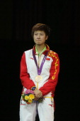 Ning Ding of China attends the medal ceremony of the Women's Singles Table Tennis match on Day 5 of the London 2012 Olympic Games at ExCeL on August...