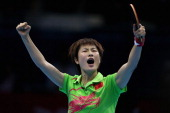 Ning Ding of China celebrates during the Women's Singles Table Tennis semifinal match against Tianwei Feng of Singapore on Day 4 of the London 2012...