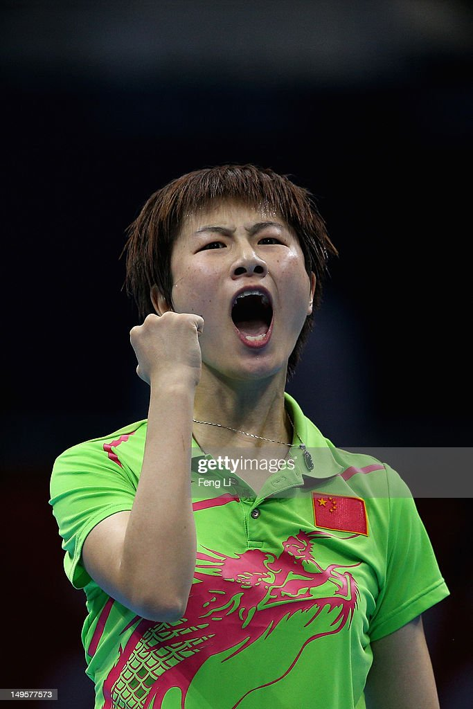 Ning Ding of China celebrates winning against Tianwei Feng of Singapore during the Women's Singles Table Tennis semi-final match on Day 4 of the London 2012 Olympic Games at ExCeL on July 31, 2012 in London, England.