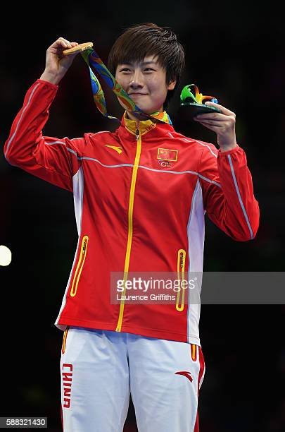 Ning Ding of China celebrates with her gold medal after victory over Li Xiaoxia of China during the Womens Table Tennis Singles Final match at Rio...