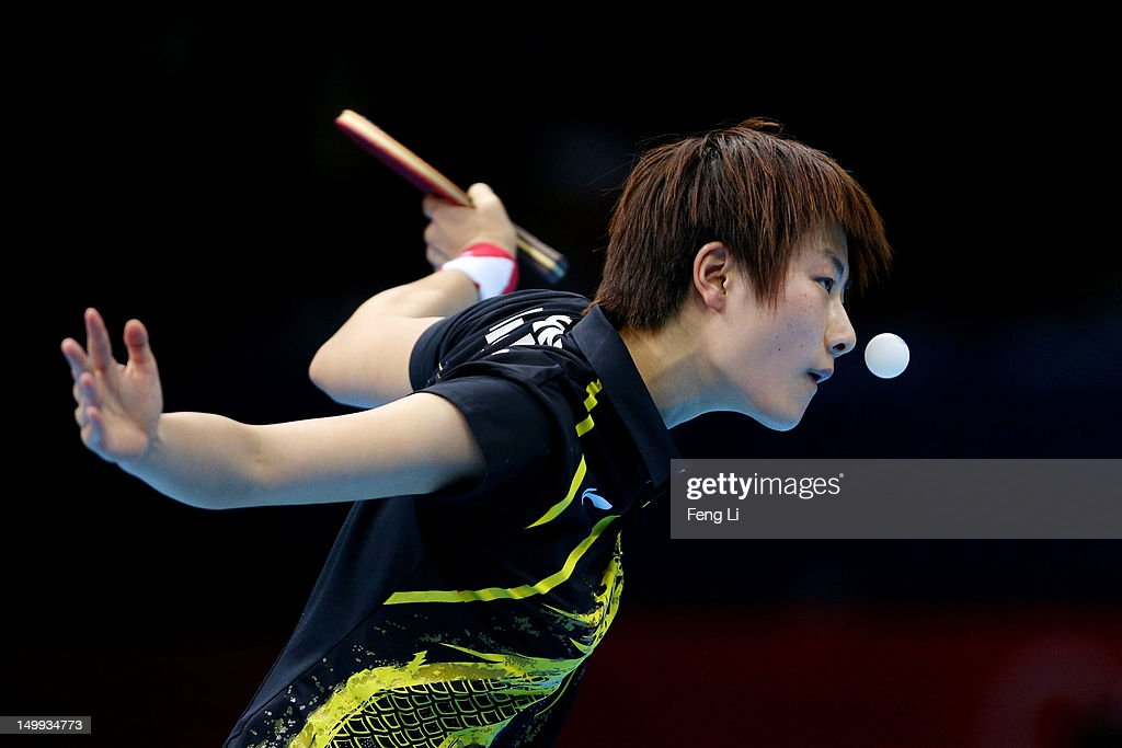 Ning Ding of China competes against Kasumi Ishikawa of Japan during the Women's Team Table Tennis gold medal match on Day 11 of the London 2012 Olympic Games at ExCeL on August 7, 2012 in London, England.