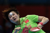 Ning Ding of China competes against Tianwei Feng of Singapore during the Women's Singles Table Tennis semifinal match on Day 4 of the London 2012...