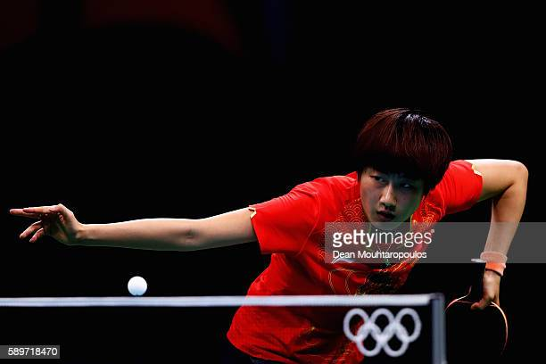 Ning Ding of China competes against Yihan Zhou of Singapore during the Table Tennis Women's Team Round Semi Final between China and Singapore during...