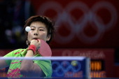 Ning Ding of China competes during her Women's Singles Table Tennis Gold Medal match against Xiaoxia Li of China on Day 5 of the London 2012 Olympic...