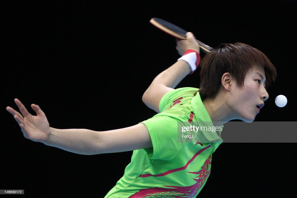 Ning Ding of China eyes the ball during her Women's Singles Table Tennis fourth round match against Huajun Jiang of Hong Kong, China on Day 3 of the London 2012 Olympic Games at ExCeL on July 30, 2012 in London, England.