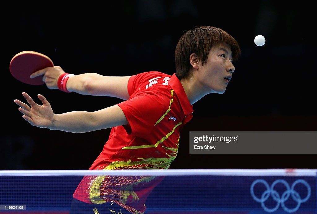 Ning Ding of China in action against Kyungah Kim of Korea during the women's team table tennis semifinals on Day 10 of the London 2012 Olympic Games at ExCeL on August 6, 2012 in London, England.