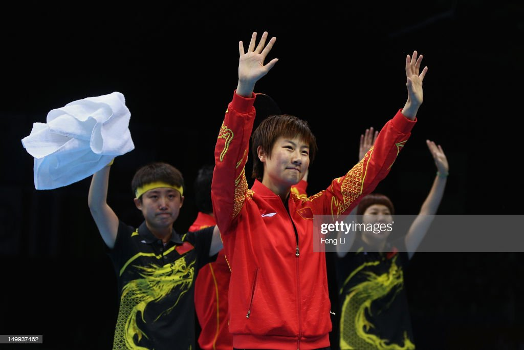 Ning Ding Xiaoxia Li and Yue Guo of China celebrate defeating Japan to win the Women's Team Table Tennis gold medal match on Day 11 of the London...