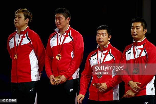 Ning Gao and Hu Li of Singapore and Zhang Zi and Jian Zhan of Singapore pose on the podium with their medals after the Men's Table Tennis doubles...