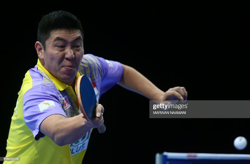 Ning Gao of Singapore returns the ball to Xin Xu of China during their men's singles semi-final table tennis match in the ITTF Nakheel Table Tennis Asian Cup, on April 29, 2016 in Dubai. / AFP / MARWAN