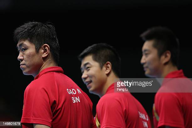Ning Gao Zi Yang and Jian Zhan of Singapore attend the Men's Team Table Tennis first round match against team of Australia on Day 8 of the London...