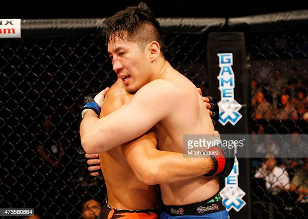 Ning Guangyou of China and Royston Wee of Singapore congratulate each other after their bantamweight fight during the UFC Fight Night event at the...