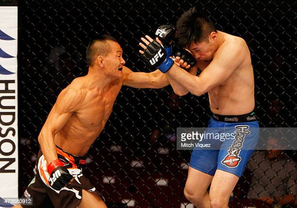 Ning Guangyou of China punches Royston Wee of Singapore in their bantamweight fight during the UFC Fight Night event at the Mall of Asia Arena on May...