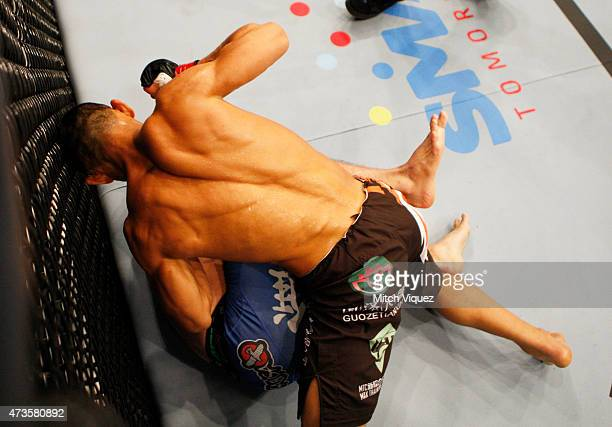 Ning Guangyou of China throws strikes on Royston Wee of Singapore in their bantamweight fight during the UFC Fight Night event at the Mall of Asia...
