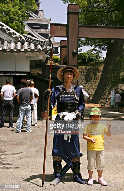 Ninja and Japanese kid pose in front of Kumamoto Castle a large and in its days extremely wellfortified Japanese castle The donjon or castle central...