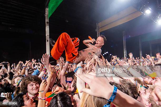 Ninja of Die Antwoord performs in the crowd during the Buku Music Arts Festival at Mardi Gras World on March 13 2015 in New Orleans Louisiana