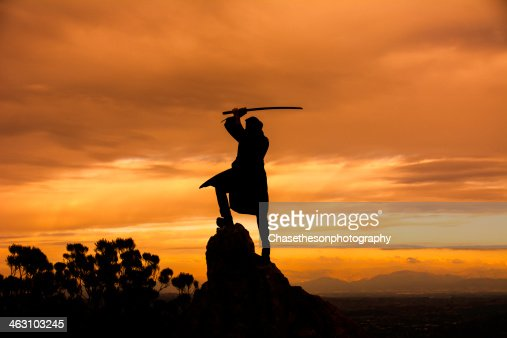 Ninja posing with katana on top of a mountain