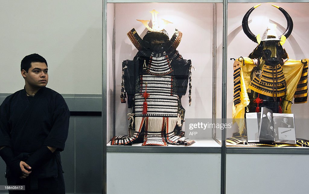 A Ninjutsu student looks at a cabinet displaying Samurais' wardrobe used in the XV century, during the 'Japan and its Ancestral Warriors' exhibition, in Monterrey, Mexico on December 15, 2012. AFP PHOTO/Julio Cesar Aguilar