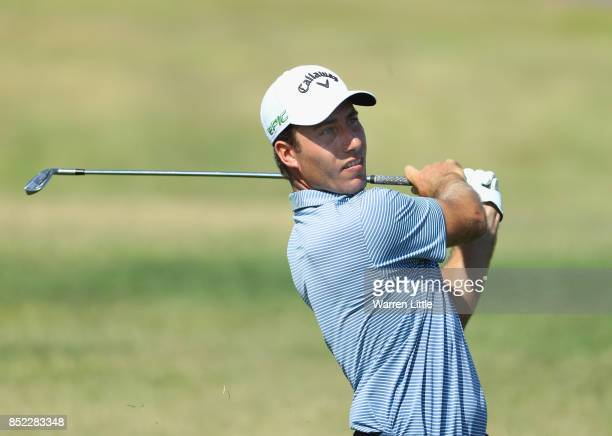 Nino Bertasio of Italy plays his second shot into the ninth green during the Portugal Masters at the Oceanico Victoria Golf Club on September 23 2017...