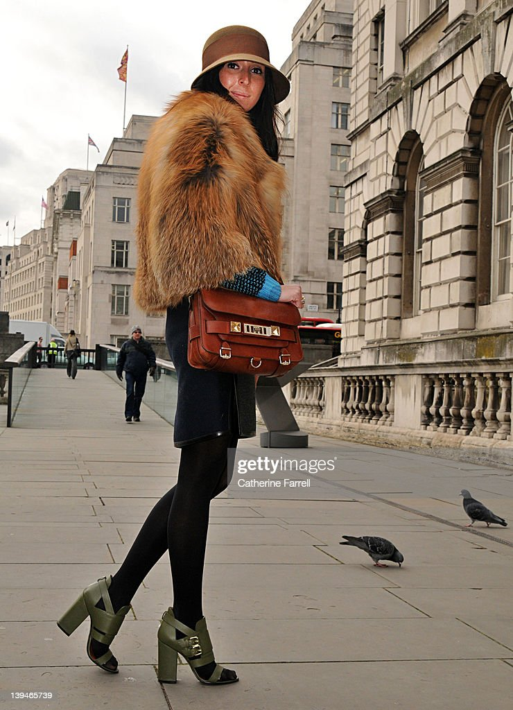 Nino Eliava, Gracia Street fashion reporter at LFW wearing vintage Fur Jacket, Sweater by Jonathan Saunders, , Shirt Tatanaka, Gun metal grey Skirt by Balenciaga, Givenchy shoes and Tan Proenza Schouler bag at London Fashion Week Autumn/Winter 2012 at on February 21, 2012 in London, England.