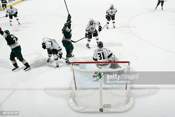 Nino Niederreiter and Chris Stewart of the Minnesota Wild celebrate a goal against Martin Jones as Jake Muzzin Drew Doughty and Jeff Carter of the...