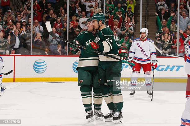 Nino Niederreiter celebrates with his Minnesota Wild teammate Matt Cooke after scoring a goal against the New York Rangers during the game on March...