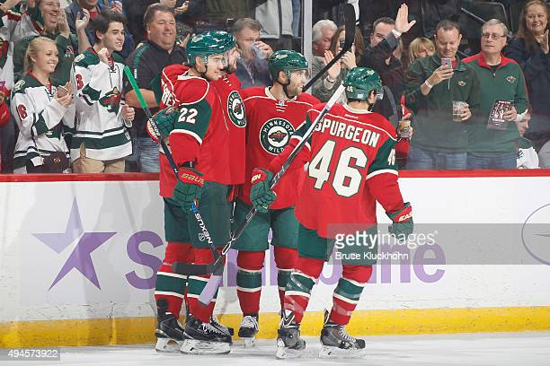 Nino Niederreiter Marco Scandella Jason Zucker and Jared Spurgeon of the Minnesota Wild celebrate after scoring a goal against the Edmonton Oilers...