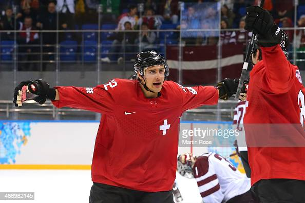 Nino Niederreiter of Switzerland celebrates after scoring a goal late in the third period against Edgars Masalskis of Latvia during the Men's Ice...