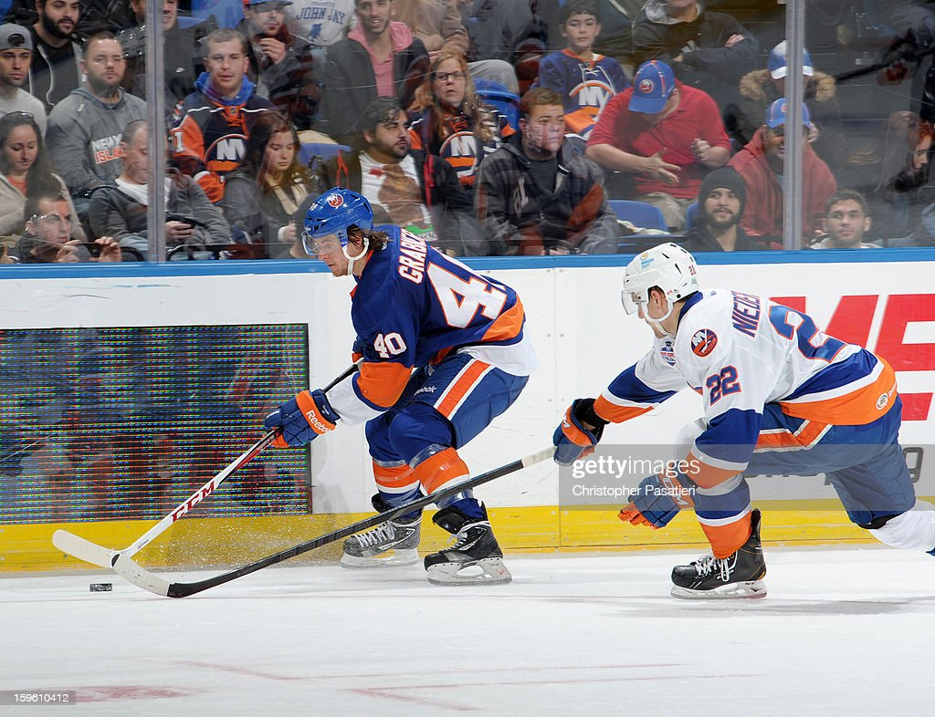 Nino Niederreiter #22 of Team White reaches for the puck against Michael Grabner #40 of Team Blue during a scrimmage match between players of the New York Islanders and Bridgeport Sound Tigers on January 16, 2013 at Nassau Veterans Memorial Coliseum in Uniondale, New York.