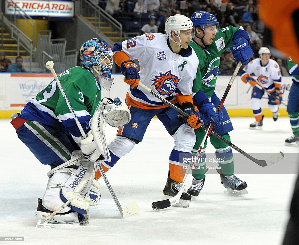 Nino Niederreiter #22 of the Bridgeport Sound Tigers battles for position with Blake Parlett #5 of the Connecticut Whale in front of Cameron Talbot #33 during an American Hockey League game on March 3, 2013 at the Webster Bank Arena at Harbor Yard in Bridgeport, Connecticut.