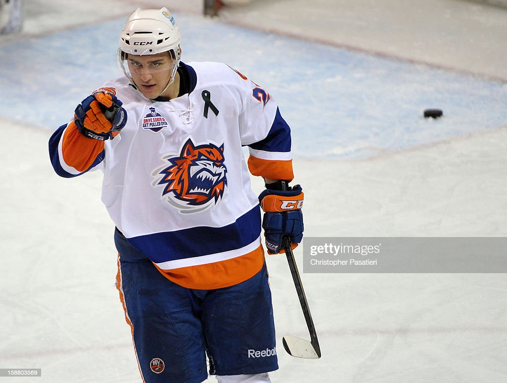Nino Niederreiter #22 of the Bridgeport Sound Tigers reacts after scoring a goal during an American Hockey League game against the Manchester Monarchs on December 29, 2012 at the Webster Bank Arena at Harbor Yard in Bridgeport, Connecticut.