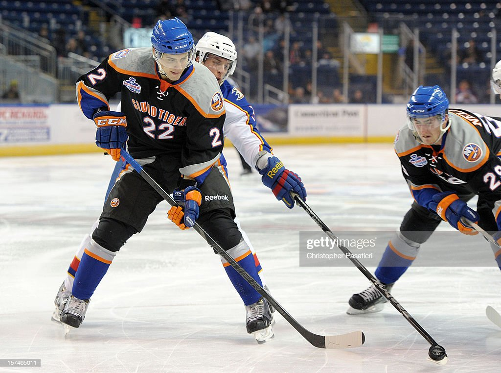Nino Niederreiter #22 of the Bridgeport Sound Tigers skates against Nate Guenin #5 of the Norfolk Admirals during an American Hockey League game on December 2, 2012 at the Webster Bank Arena in Bridgeport, Connecticut. The Admirals defeated the Sound Tigers 4-1.