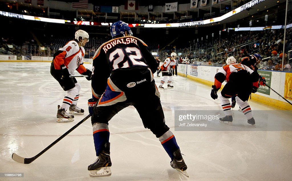 Nino Niederreiter #22 of the Bridgeport Sound Tigers wears a jersey in memory of Sandy Hook Elementary School shooting victim Chase Kowalski during an American Hockey League game against the Adirondack Phantoms at Webster Bank Arena at Harbor Yard on December 22, 2012 in Bridgeport, Connecticut.