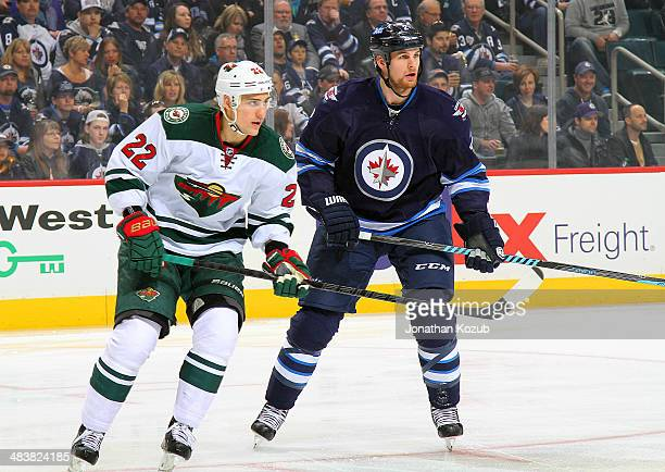 Nino Niederreiter of the Minnesota Wild and Adam Pardy of the Winnipeg Jets keep an eye on the play during first period action at the MTS Centre on...