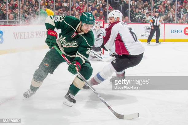 Nino Niederreiter of the Minnesota Wild and Erik Johnson of the Colorado Avalanche battle for the puck during the game on April 2 2017 at the Xcel...