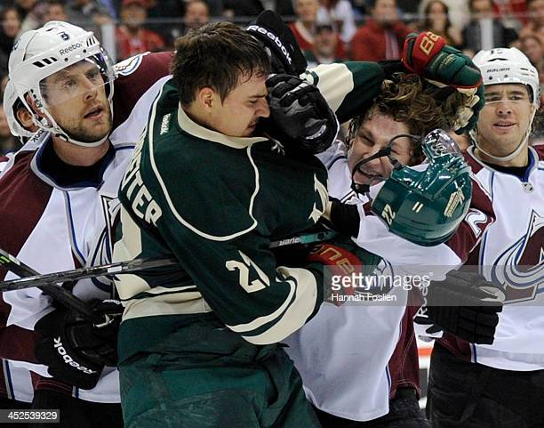 Nino Niederreiter of the Minnesota Wild and Nathan MacKinnon of the Colorado Avalanche fight during the second period of the game on November 29 2013...