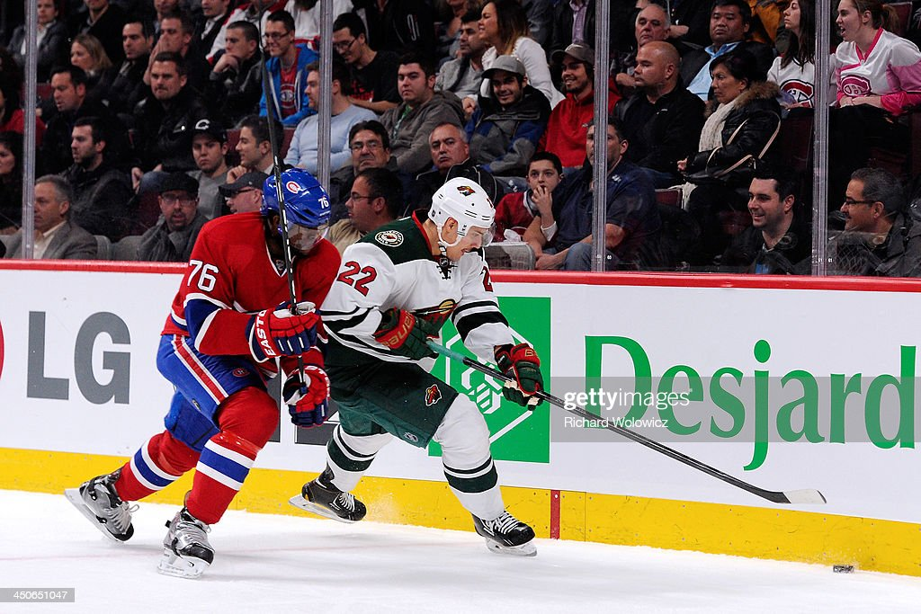 Nino Niederreiter #22 of the Minnesota Wild and P.K. Subban #76 of the Montreal Canadiens chase the puck into the corner during the NHL game at the Bell Centre on November 19, 2013 in Montreal, Quebec, Canada. The Canadiens defeated the Wild 6-2.
