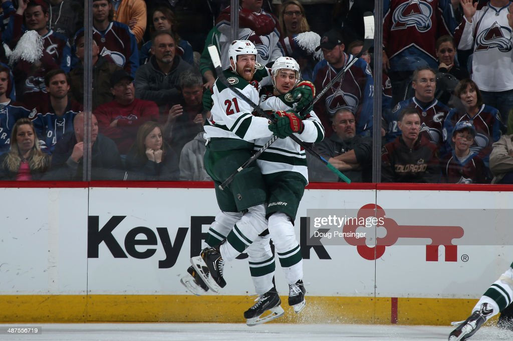 Nino Niederreiter of the Minnesota Wild celebrates his game winning goal with Kyle Brodziak of the Minnesota Wild in overtime against the Colorado...