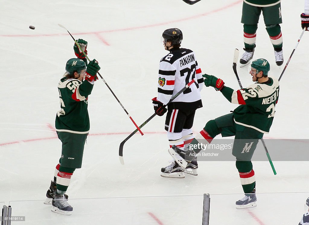 Nino Niederreiter of the Minnesota Wild celebrates his goal at 226 of the second period against the Chicago Blackhawks and is joined by Erik Haula at...