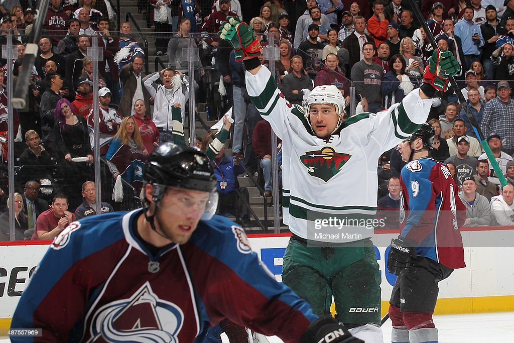 Nino Niederreiter of the Minnesota Wild celebrates his overtime serieswinning goal as Erik Johnson of the Colorado Avalanche reacts in Game Seven of...
