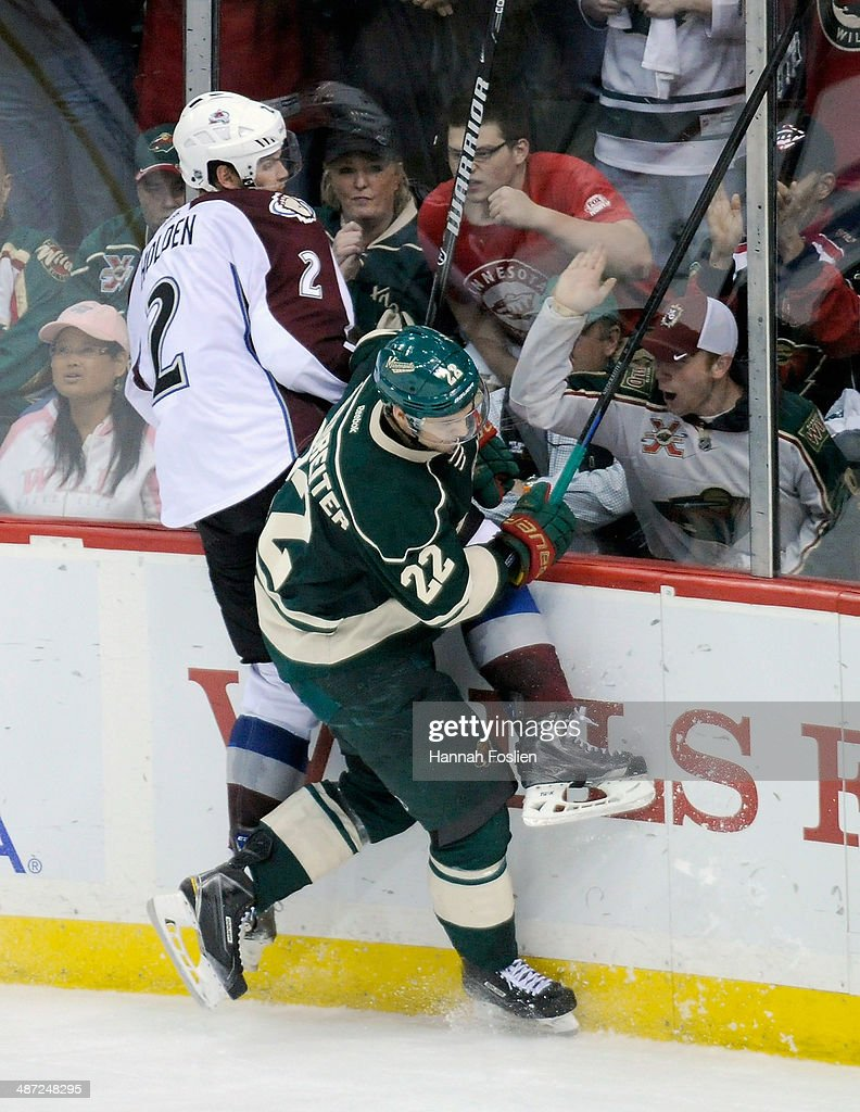 Nino Niederreiter #22 of the Minnesota Wild checks Nick Holden #2 of the Colorado Avalanche into the boards during the third period in Game Six of the First Round of the 2014 NHL Stanley Cup Playoffs on April 28, 2014 at Xcel Energy Center in St Paul, Minnesota. The Wild defeated the Avalanche 5-2.