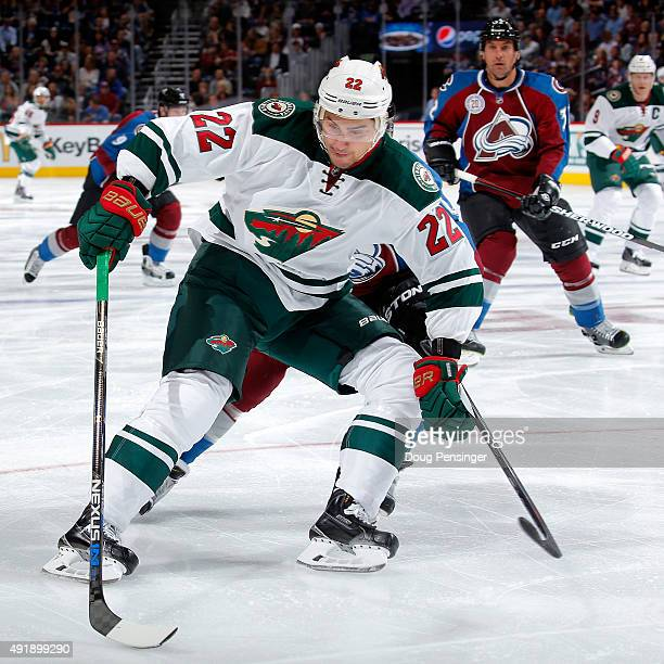 Nino Niederreiter of the Minnesota Wild controls the puck against the Colorado Avalanche at Pepsi Center on October 8 2015 in Denver Colorado