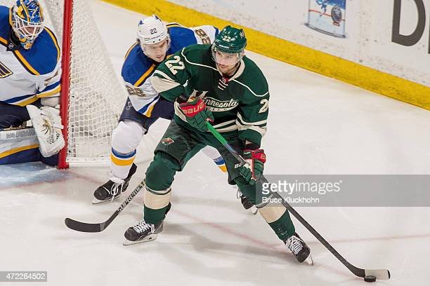 Nino Niederreiter of the Minnesota Wild handles the puck with Kevin Shattenkirk and goalie Jake Allen of the St Louis Blues defending in Game Six of...