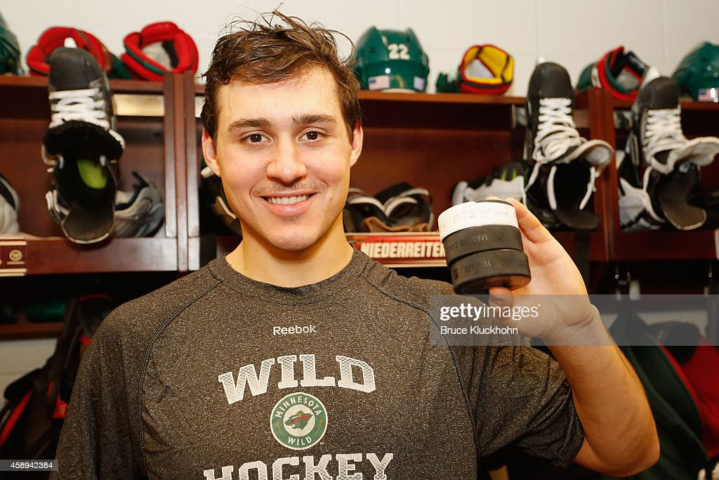 Nino Niederreiter of the Minnesota Wild holds up 3 pucks from his 3 goals after recording a hat trick against the Buffalo Sabres on November 13 2014...