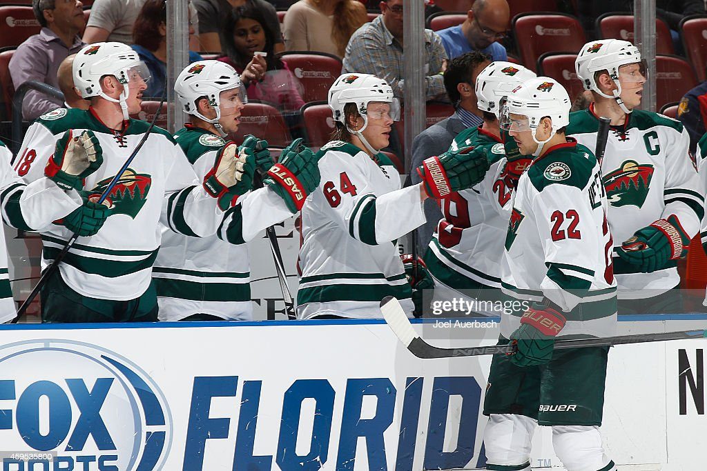 Nino Niederreiter of the Minnesota Wild is congratulated by teammates after scoring a first period goal against the Florida Panthers at the BBT...