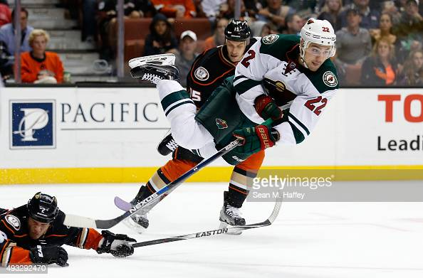 Nino Niederreiter of the Minnesota Wild leaves his skates as Kevin Bieksa of the Anaheim Ducks and Ryan Getzlaf of the Anaheim Ducks defend during...