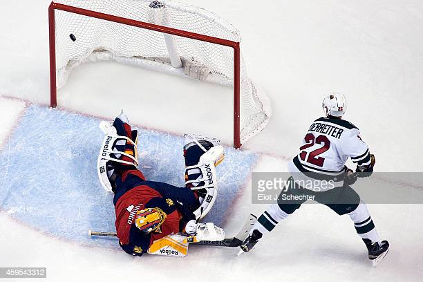 Nino Niederreiter of the Minnesota Wild scores against Goaltender Roberto Luongo of the Florida Panthers at the BBT Center on November 24 2014 in...