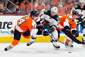 Nino Niederreiter of the Minnesota Wild skates against Matt Read and Nick Cousins of the Philadelphia Flyers during the second period at the Wells...
