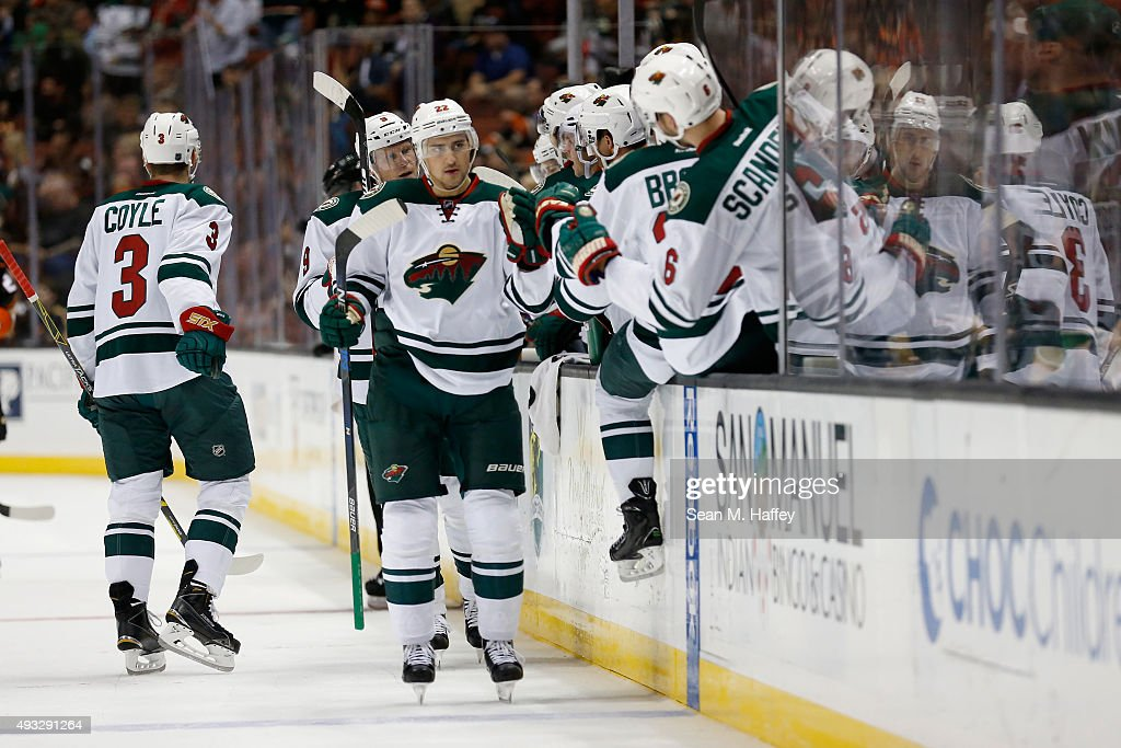 Nino Niederreiter of the Minnesota Wild skates by the Minnesota Wild bench after scoring during the first period of a game against the Anaheim Ducks...