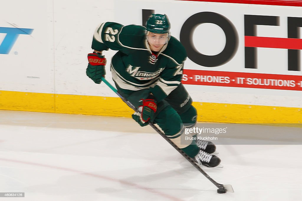 Nino Niederreiter of the Minnesota Wild skates with the puck against the Boston Bruins during the game on December 17 2014 at the Xcel Energy Center...